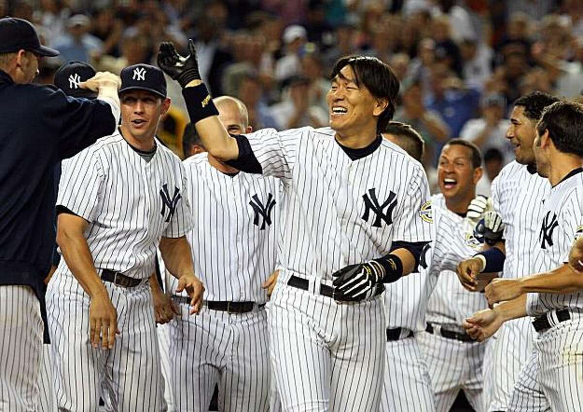 NEW YORK - JULY 20: Hideki Matsui #55 of the New York Yankees celebrates his game winning ninth inning home run against the Baltimore Orioles with his teammates on July 20, 2009 at Yankee Stadium in the Bronx borough of New York City. The Yankees defeated the Orioles 2-1. (Photo by Jim McIsaac/Getty Images)