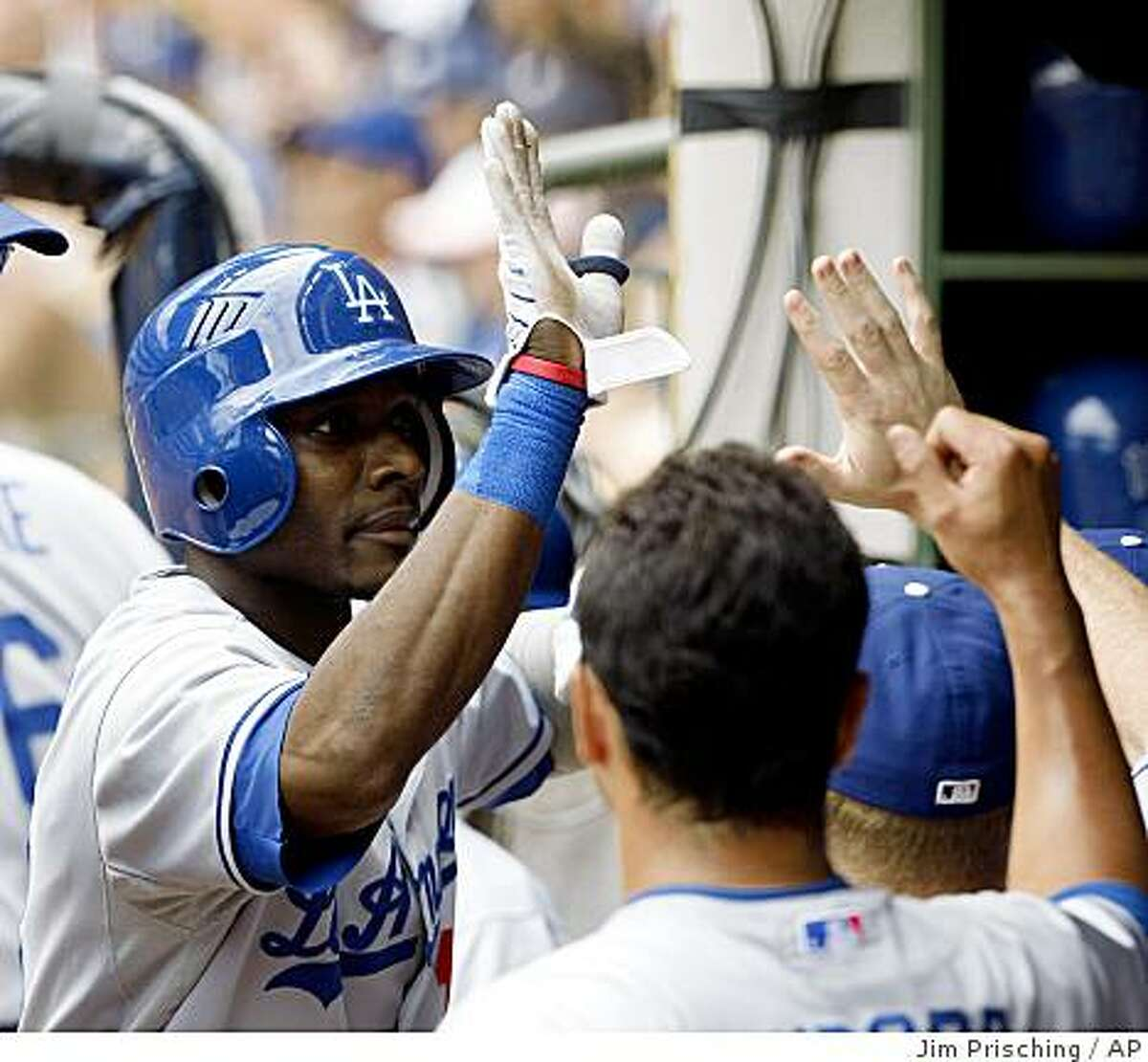 Los Angeles Dodgers' Orlando Hudson is congratulated by teammates after his second home run against the Milwaukee Brewers during the eighth inning of a baseball game Sunday, July 12, 2009, in Milwaukee. The Dodgers defeated the Brewers 7-4. (AP Photo/Jim Prisching)