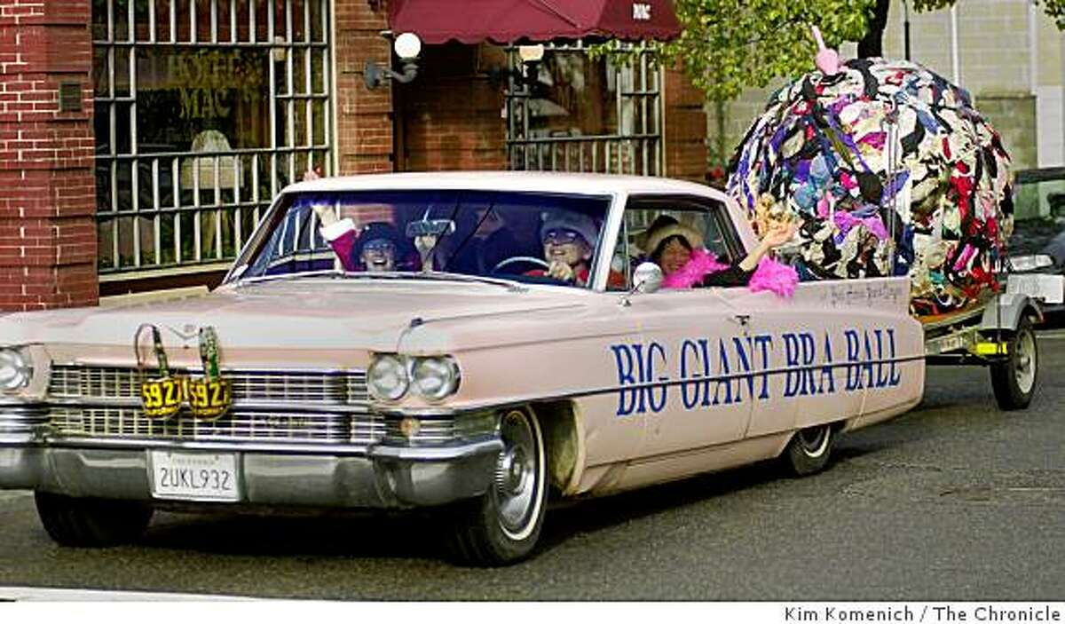 """Ron Nicolino of Point Richmond celebrates the Winter Solstice Saturday afternoon by dressing up all comers, dubbing them """"midgets"""" , piling them into his pink 1963 Cadillac and driving them around the Point Richmond town square as participants in """"Uncle Buster and the Seven Midgets Parade""""."""