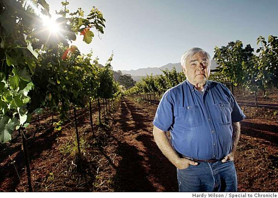 Guinness McFadden poses for a portrait between a row of Sauvignon blanc vines on his ranch in Potter Valley, Calif., on Wednesday, June 30, 2009. McFadden has been growing grapes on his ranch for 38 years for different wineries. Photo: Hardy Wilson, Special To Chronicle