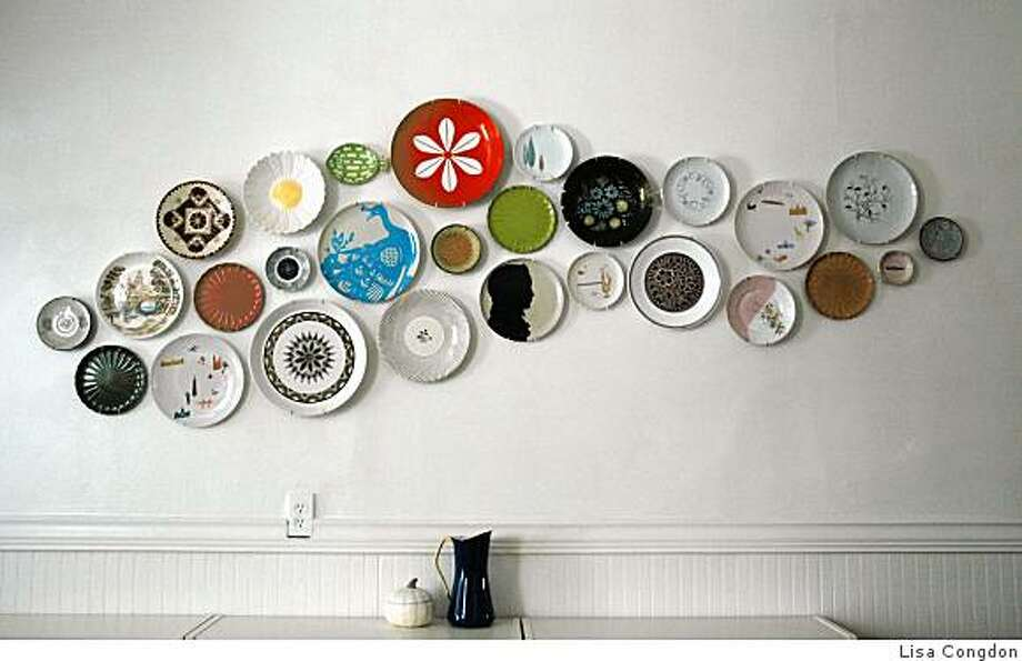 Lisa Congdon (lisacongdon.com), who co-owns the Rare Device shop in San Francisco, turned her eclectic collection of mismatched plates into an eye-catching display in her kitchen. Photo: Lisa Congdon