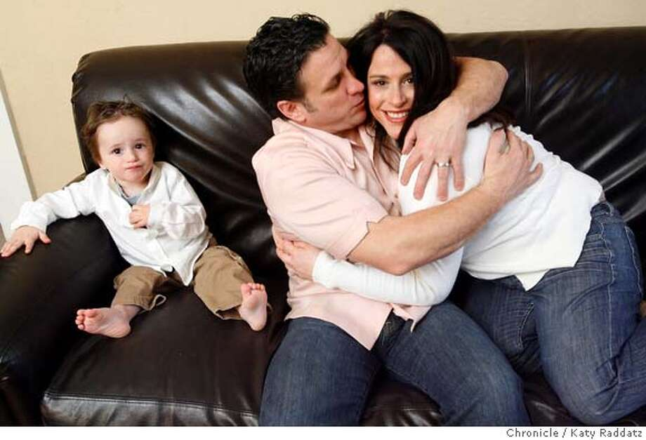 Mary and Sebastian Scala and their 22-month-old son Guiseppe Scala, on the couch in their flat in San Francisco, Calif. on Sunday, February 24, 2008.  Katy Raddatz/THE CHRONICLE Photo: KATY RADDATZ