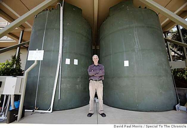 Frank Levinson shows off his huge cisterns that collect enough rainwater runoff to water his garden all summer at his eco-friendly home July 2, 2009 in Tiburon, Calif. (Photograph by David Paul Morris/Special to The Chronicle) Photo: David Paul Morris, Special To The Chronicle