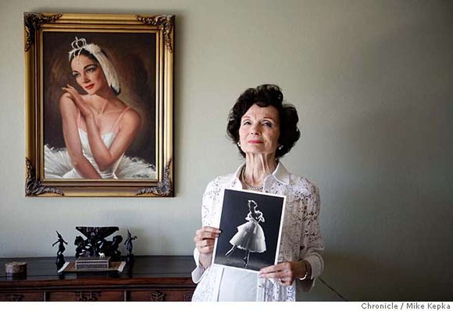 Jocelyn Vollmar, 82, holds a photo taker of herself in 1950s. She danced in the SF Ballet's first nutcracker in the 1940s, witch sparked a multi-decade career in San Francisco and beyond.  photo by Mike Kepka / San Francisco Chronicle Ran on: 03-09-2008 Photo: Mike Kepka