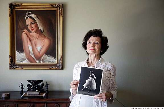 Jocelyn Vollmar, 82, holds a photo taker of herself in 1950s. She danced in the SF Ballet's first nutcracker in the 1940s, witch sparked a multi-decade career in San Francisco and beyond.  photo by Mike Kepka / San Francisco Chronicle Ran on: 03-09-2008