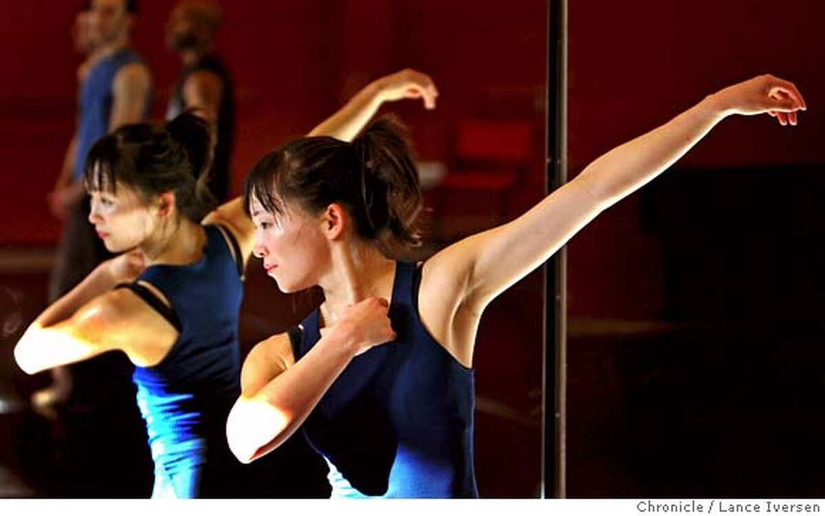 ###Live Caption:Professional dancer Yayoi Kambara is reflected in the mirrors during her rehearsal at ODC Dance Commons in the Mission for an upcoming series of performance at Yerba Buena Gardens titled Dancing Downtown. Kambara is in a unique but not alone position of balancing her married life with her husband, Dr. R. Richard Coughlin, a doctor at the free clinic at ODC, and raising her ten-month-old baby, Hanae Cricket Kambara-Coughlin. Photographed Tuesday March 4, 2008 in SAN FRANCISCO. Photo By Lance Iversen / San Francisco Chronicle.###Caption History:Professional dancer Yayoi Kambara is reflected in the mirrors during her rehearsal at ODC Commons for an upcoming series of performance at Yuba Buna Gardens titled Dancing Downtown. Kambara is in a unique but not alone position of balancing her married life with her husband, Dr. R. Richard Coughlin, a doctor at the free clinic at ODC, and raising her ten-month-old baby, Hanae Cricket Kambara-Coughlin. Photographed Tuesday March 4, 2008 in SAN FRANCISCO. Photo By Lance Iversen / San Francisco Chronicle.###Notes:Iversen 415-297-9395 CQ###Special Instructions:MANDATORY CREDIT PHOTOG AND SAN FRANCISCO CHRONICLE/NO SALES MAGS OUT