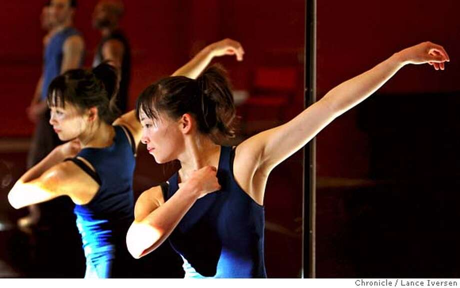 ###Live Caption:Professional dancer Yayoi Kambara is reflected in the mirrors during her rehearsal at ODC Dance Commons in the Mission for an upcoming series of performance at Yerba Buena Gardens titled Dancing Downtown. Kambara is in a unique but not alone position of balancing her married life with her husband, Dr. R. Richard Coughlin, a doctor at the free clinic at ODC, and raising her ten-month-old baby, Hanae Cricket Kambara-Coughlin. Photographed Tuesday March 4, 2008 in SAN FRANCISCO. Photo By Lance Iversen / San Francisco Chronicle.###Caption History:Professional dancer Yayoi Kambara is reflected in the mirrors during her rehearsal at ODC Commons for an upcoming series of performance at Yuba Buna Gardens titled Dancing Downtown. Kambara is in a unique but not alone position of balancing her married life with her husband, Dr. R. Richard Coughlin, a doctor at the free clinic at ODC, and raising her ten-month-old baby, Hanae Cricket Kambara-Coughlin. Photographed Tuesday March 4, 2008 in SAN FRANCISCO. Photo By Lance Iversen / San Francisco Chronicle.###Notes:Iversen 415-297-9395 CQ###Special Instructions:MANDATORY CREDIT PHOTOG AND SAN FRANCISCO CHRONICLE/NO SALES MAGS OUT Photo: Lance Iversen