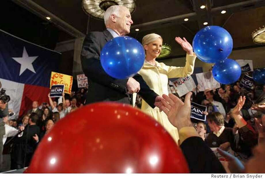 ###Live Caption:Republican US presidential candidate Senator John McCain (R-AZ) and his wife Cindy wave as ballons drop after his speech at his Ohio and Texas primary election night rally in Dallas, Texas March 4, 2008. REUTERS/Brian Snyder (UNITED STATES) US PRESIDENTIAL ELECTION CAMPAIGN 2008 (USA)###Caption History:Republican US presidential candidate Senator John McCain (R-AZ) and his wife Cindy wave as ballons drop after his speech at his Ohio and Texas primary election night rally in Dallas, Texas March 4, 2008. REUTERS/Brian Snyder (UNITED STATES) US PRESIDENTIAL ELECTION CAMPAIGN 2008 (USA)###Notes:Republican US presidential candidate Senator John McCain and his wife Cindy wave as ballons drop after his speech at his Ohio and Texas primary election night rally in Dallas###Special Instructions:0 Photo: BRIAN SNYDER