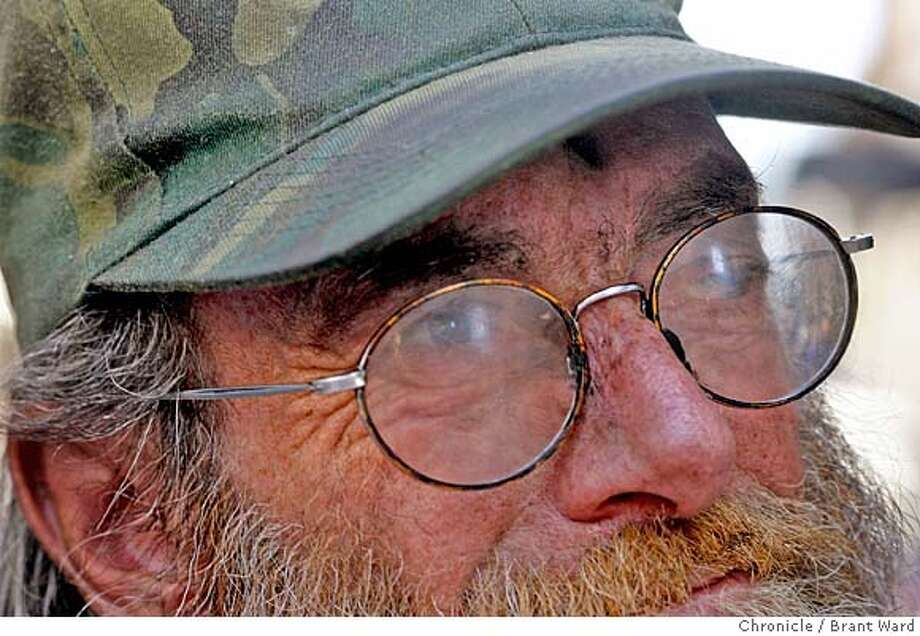 a81ce64fb601 landscape008.jpg Michael Dick wears glasses that are so scratched he has  difficulty seeing out