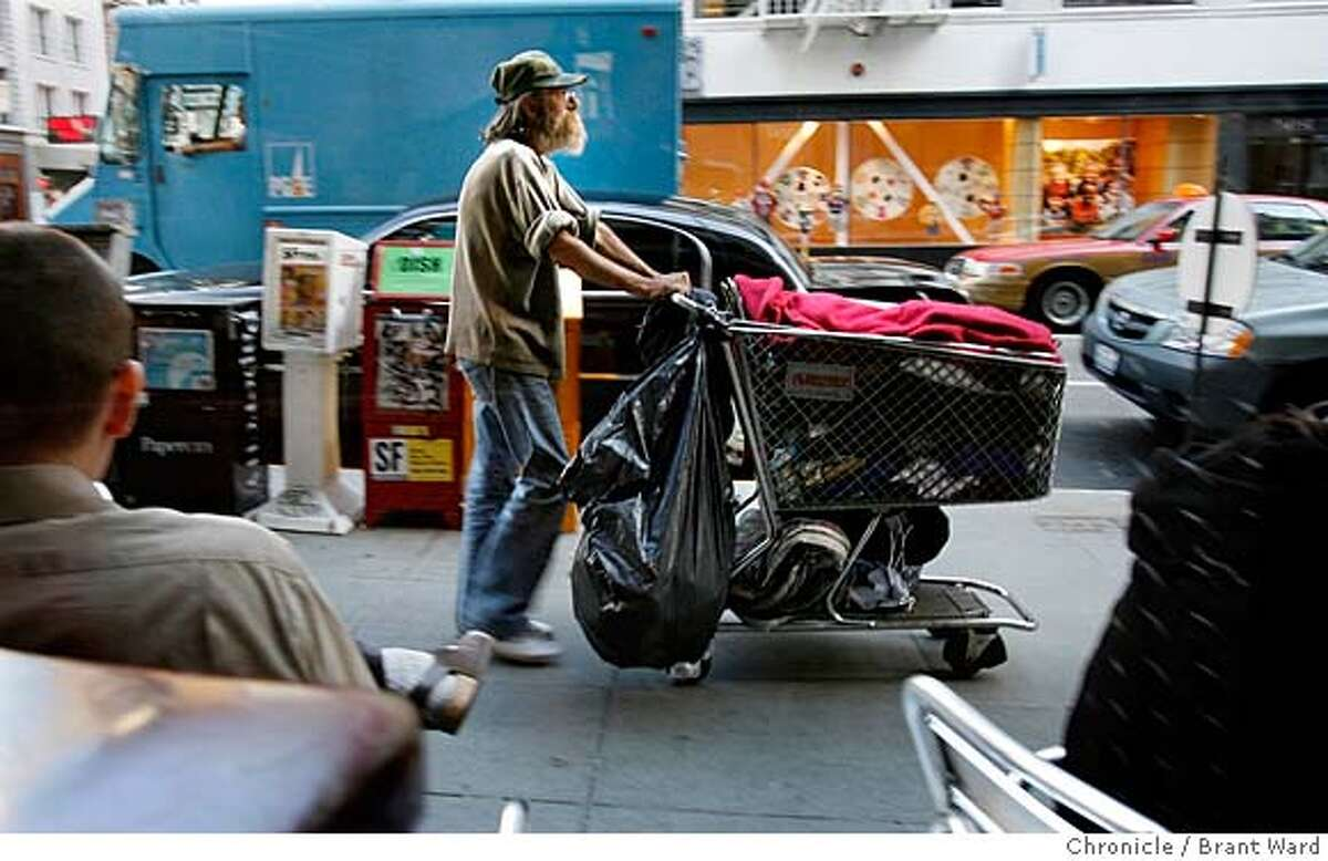 landscape007.jpg Michael begins pushing his cart down Sutter Street toward Market Street in the morning. Michael Dick is typical of the longtime chronic homeless in San Francisco. He has been living on the streets for over a decade, manages to make a little money recycling, and has medical problems that are forcing him to rethink his lifestyle. He decides to get General Assistance and get permanent housing after growing tired of wandering the streets. {Brant Ward/The Chronicle} 7/20/06 MANDATORY CREDIT FOR PHOTOGRAPHER AND SAN FRANCISCO CHRONICLE/NO SALES-MAGS OUT