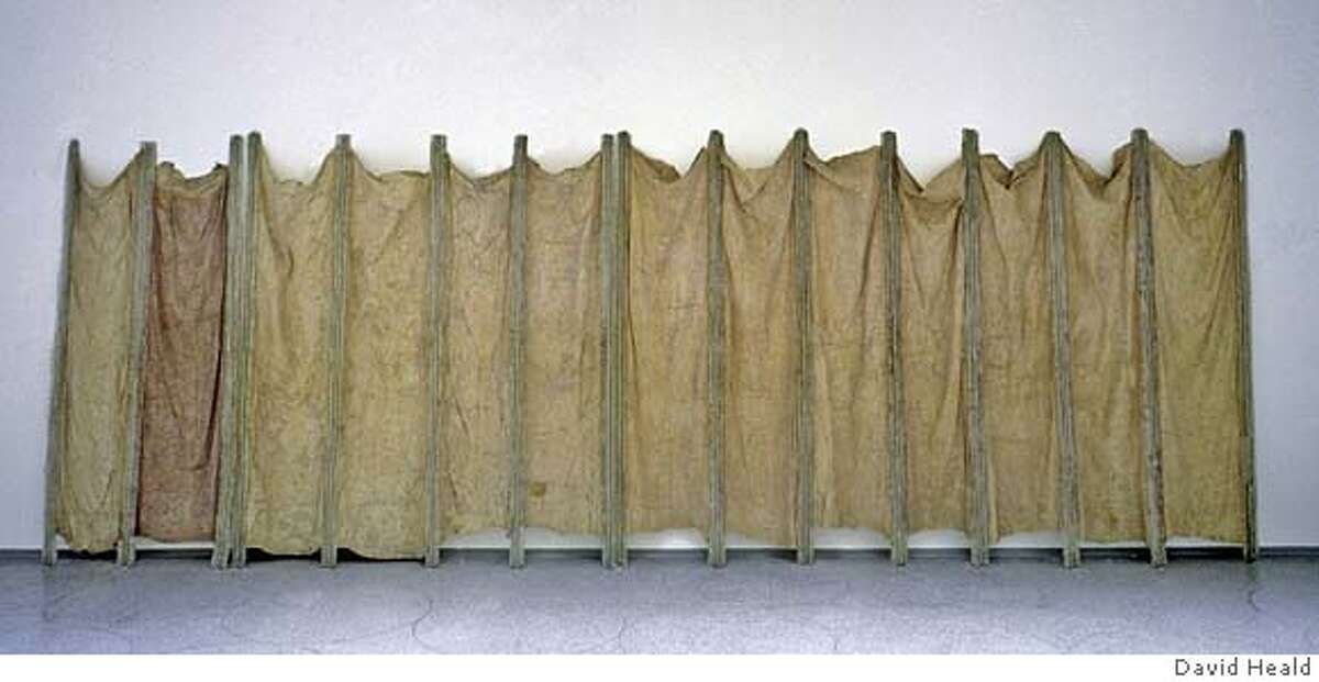 """Eva Hesse's piece called """"Expanded Expansion,"""" 1966 Fiberglass, polyester resin, latex and cheesecloth 122 x 300 inches (309.9 x 762 cm) overall Solomon R. Guggenheim Museum, New York Gift, Family of Eva Hesse, 1975 Photograph by David Heald. The Solomon R. Guggenheim Foundation, New York. The Estate of Eva Hesse"""