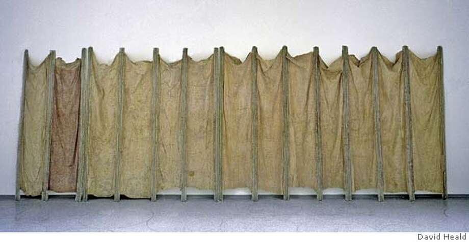 "Eva Hesse's piece called ""Expanded Expansion,"" 1966  Fiberglass, polyester resin, latex and cheesecloth  122 x 300 inches (309.9 x 762 cm) overall  Solomon R. Guggenheim Museum, New York  Gift, Family of Eva Hesse, 1975  Photograph by David Heald. The Solomon R. Guggenheim Foundation, New York. The Estate of Eva Hesse Photo: David Heald Photographer; Piece"