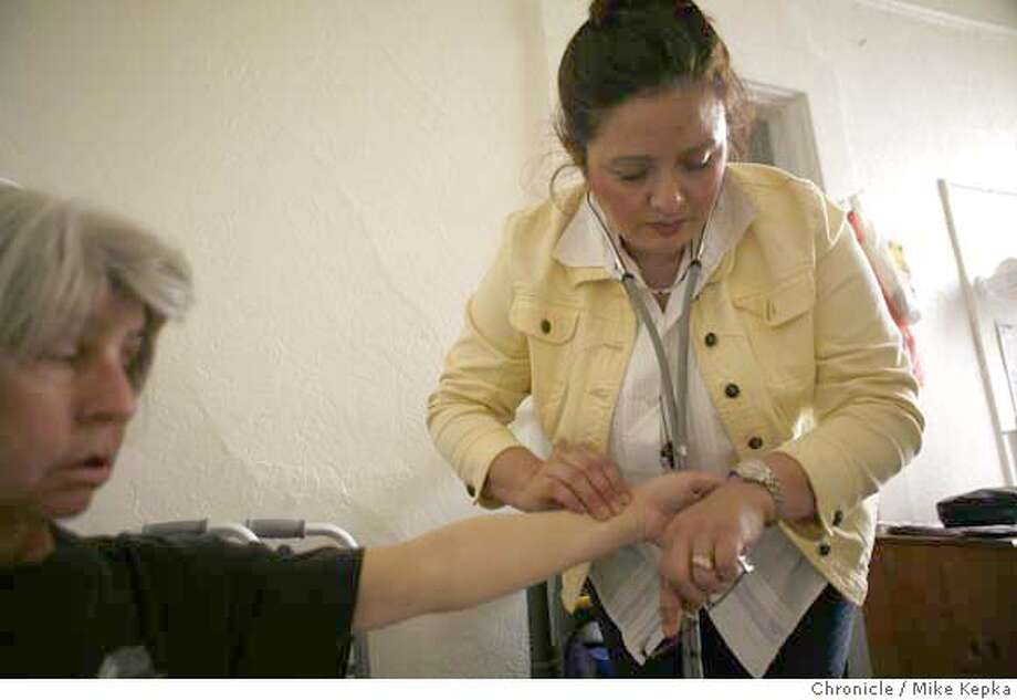 ###Live Caption:Typical of their weekly visit together, Sylvia Petrin, 59, in her apartment, has her blood pressure and pulse taken by home visiting nurse, Maria Elena Hanley in San Francisco, Calif. on Wednesday, Feb. 27, 2008. Home visits made by Hanley and her colleges will be among the first to go after $33 million budget cuts hit the public health department. Photo by Mike Kepka / San Francisco Chronicle###Caption History:Typical of their weekly visit together, Sylvia Petrin, 59, in her apartment, has her blood pressure and pulse taken by home visiting nurse, Maria Elena Hanley in San Francisco, Calif. on Wednesday, Feb. 27, 2008. Home visits made by Hanley and her colleges will be among the first to go after $33 million budget cuts hit the public health department. Photo by Mike Kepka / San Francisco Chronicle###Notes:(cq) Sylvia Petrin Maria Elena Hanley###Special Instructions:MANDATORY CREDIT FOR PHOTOG AND SAN FRANCISCO CHRONICLE/NO SALES-MAGS OUT Photo: Mike Kepka