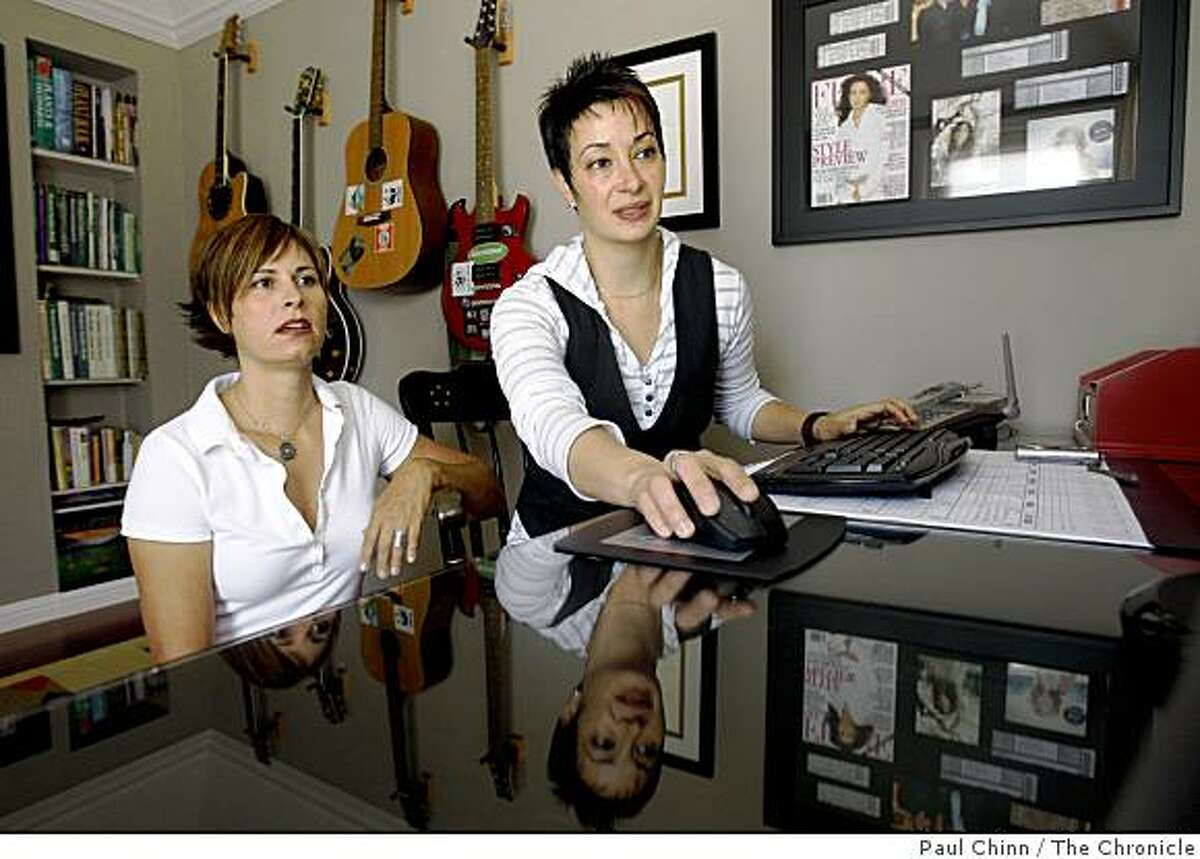 Jennifer France (left) and her partner Pouneh Toutounchian work in a home office at their home in San Carlos, Calif., on Thursday, July 2, 2009. The couple has been unable to refinance their home with a 30-year loan despite drawing good incomes from their self-employed businesses.