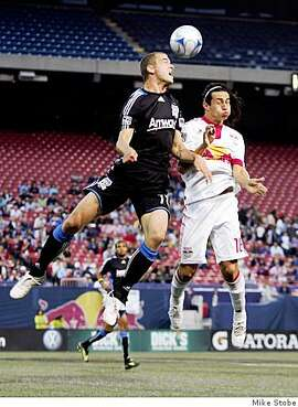 EAST RUTHERFORD, NJ - MAY 08:  Alfredo Pacheco #16 of the New York Red Bulls battles for the ball against Bobby Convey #11 of the San Jose Earthquakes at Giants Stadium in the Meadowlands on May 8, 2009 in East Rutherford, New Jersey.  (Photo by Mike Stobe/Getty Images for New York Red Bull)
