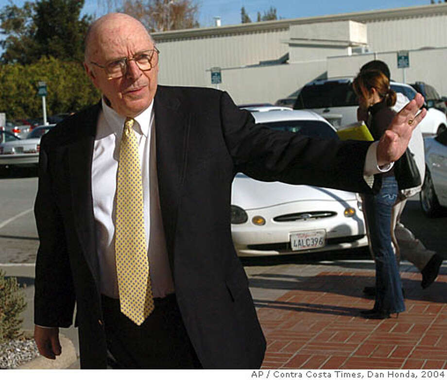 Judge Alfred Delucchi waves as he returns from the lunch break just before the verdict was read, outside of the courthouse in Redwood City, Calif., Monday, Dec. 13, 2004. The jury returned with a sentence recommendation of death in the penalty phase of the Scott Peterson case. Peterson was convicted of two counts of murder in the deaths of his wife Laci Peterson and their unborn child. (AP Photo/Contra Costa Times, Dan Honda POOL) Ran on: 02-28-2008  Judge Alfred Delucchi presided over the Scott Peterson trial. Photo: DAN HONDA