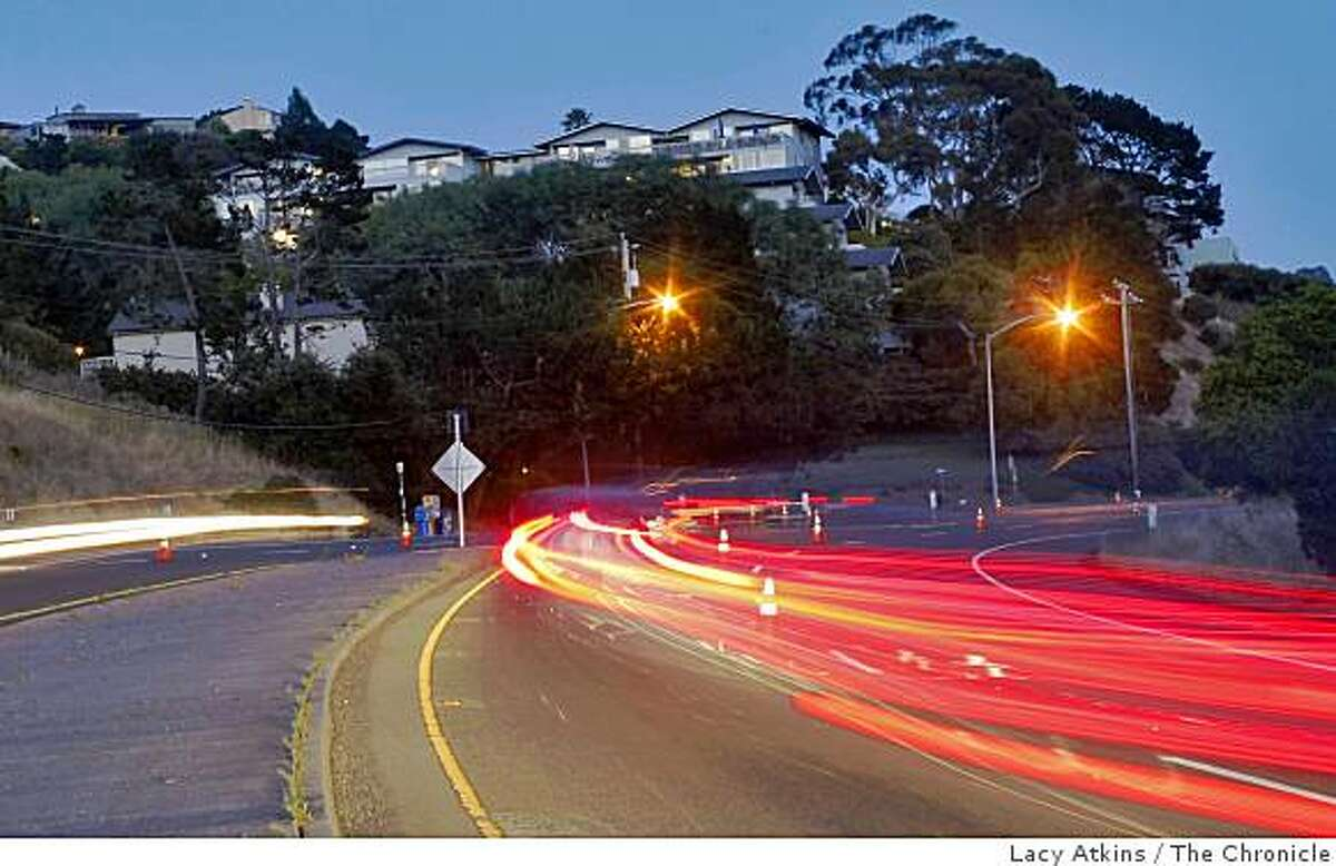 Traffic drive along Tiburon Blvd at the intersection of Blackfield Drive, Tuesday July 7, 2009, where the city is thinking of putting cameras to scan the license plates of people coming in and out of Tiburon and Belvedere,