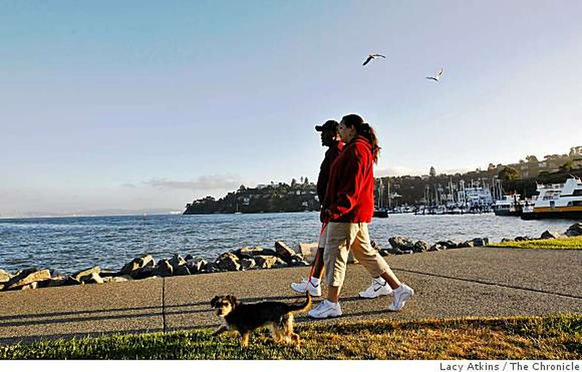 Tourist and residents walk along the waterfront, Tuesday July 7, 2009, in Tiburon, Calif.