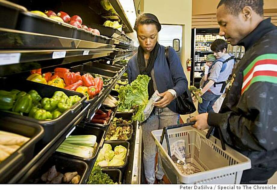 Natasha Sampson and Shomane Evans select fresh produce in the organic produce section in the month old Mandela Foods market in West Oakland, California on Jul. 7, 2009. Photo: Peter DaSilva, Special To The Chronicle