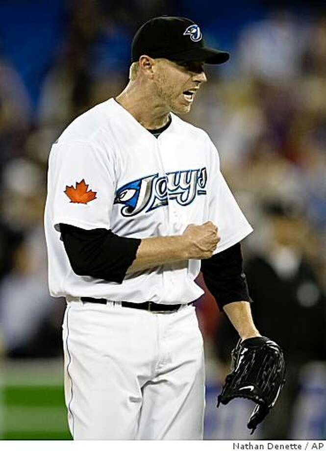 Toronto Blue Jays starting pitcher Roy Halladay reacts after defeating the Los Angeles Angels 6-4 during the ninth inning of a baseball game in Toronto, Canada, Tuesday, June 2, 2009. (AP Photo/The Canadian Press, Nathan Denette) Photo: Nathan Denette, AP