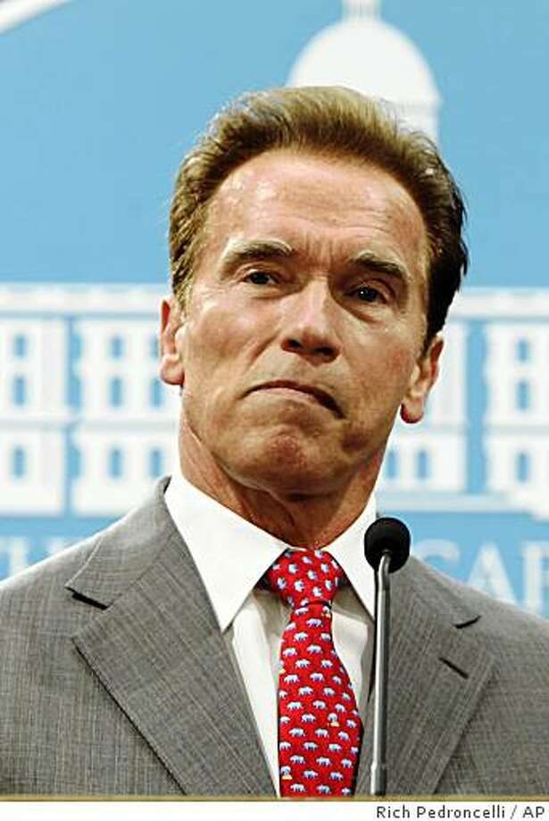 Gov. Arnold Schwarzenegger listens to a question concerning his declaration of a fiscal emergency to address California's deficit at a Capitol news conference in Sacramento, Calif., Wednesday, July 1, 2009.  Lawmakers will have 45 days to send him a plan to balance the state's budget which ended the fiscal year with a $24.3 billion deficit.(AP Photo/Rich Pedroncelli) Photo: Rich Pedroncelli, AP