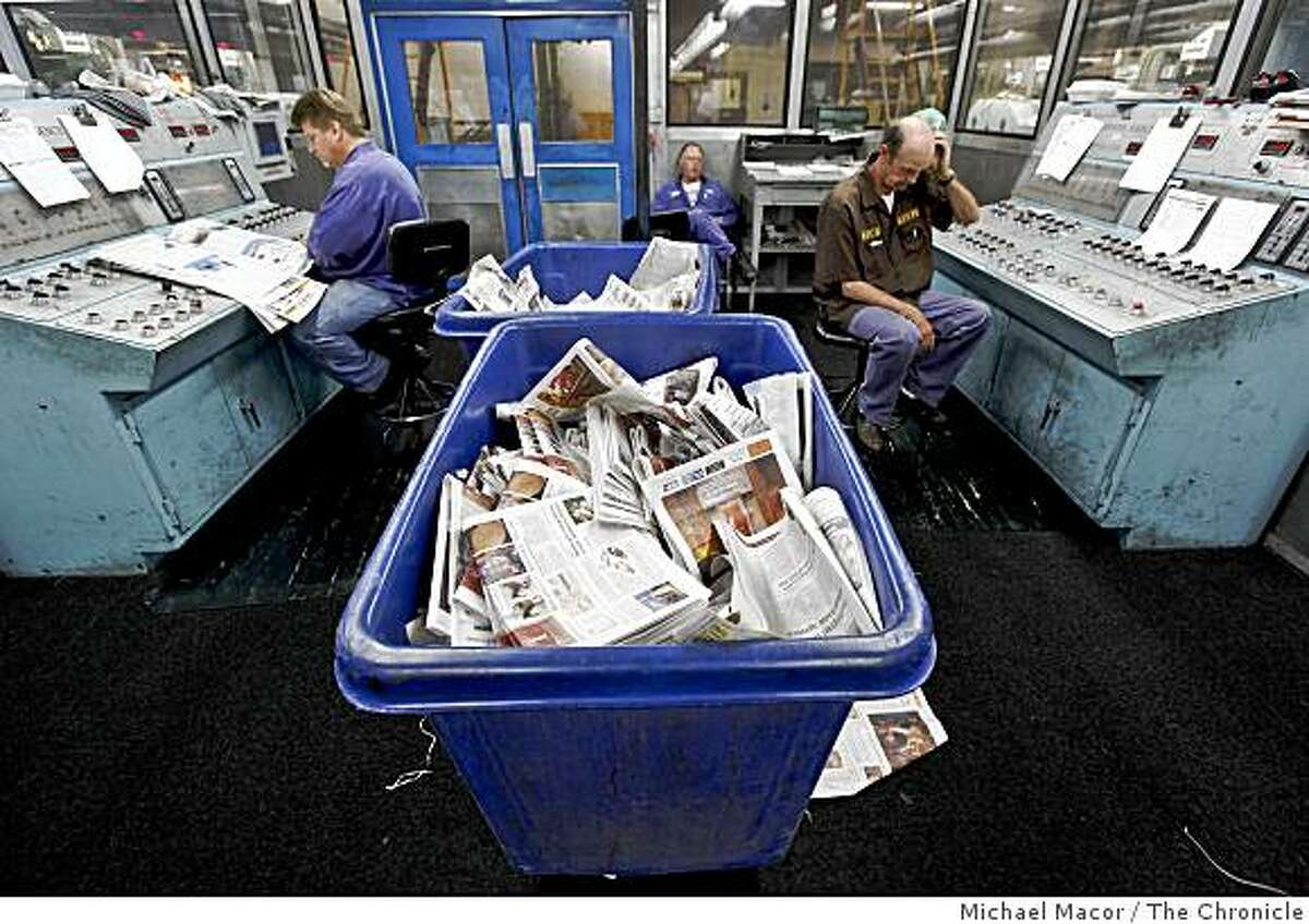 Pressman Carl Gisen, (left), Raymond Lussier and Royce Green, (right), working on the Sunday sections of the San Francisco Chronicle, from the control room, as the last papers to be produced at the Union City printing plant, on Saturday July 4, 2009, before operations are moved to a new state-of-the art facility in Fremont.