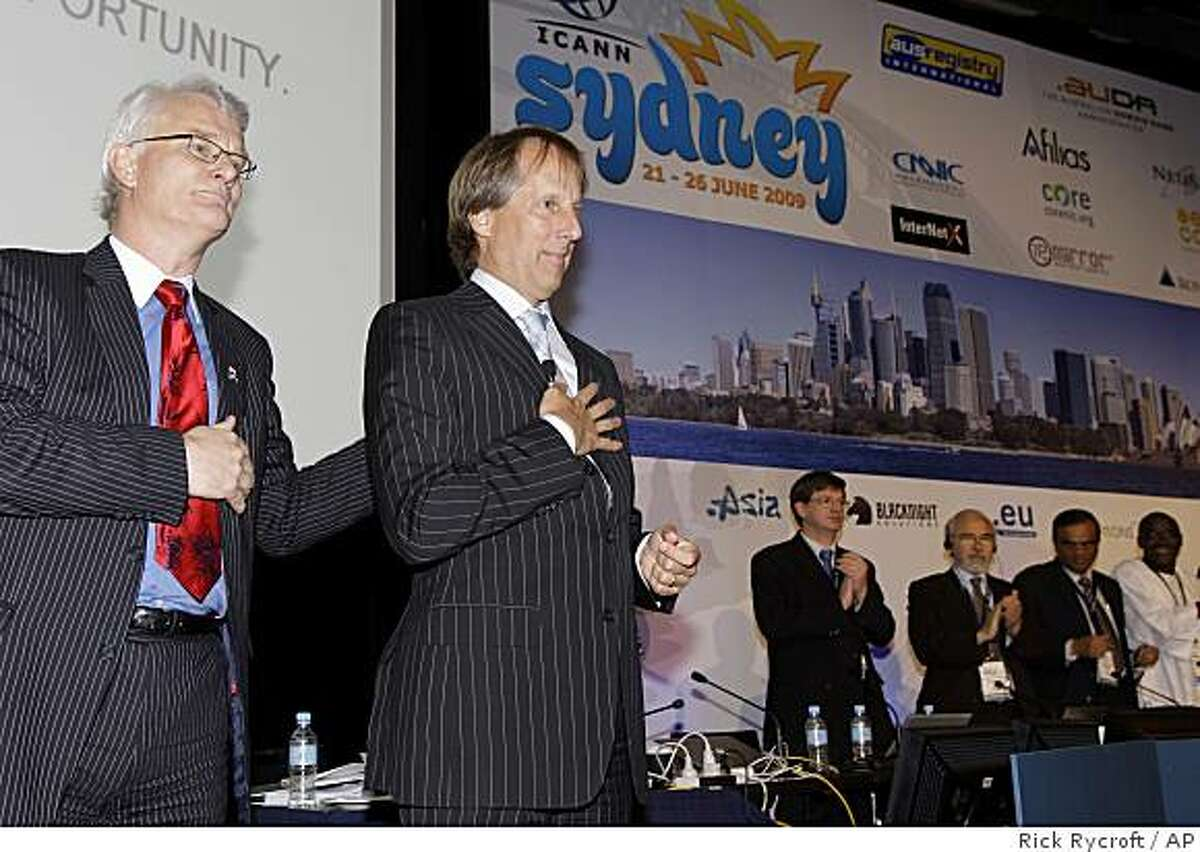 Rod Beckstrom, second left, the former U.S. cybersecurity chief, is congratulated by the Chairmon of the Board, Peter Dengate Thrush, left, after Beckstrom was announced as the next chief executive of the Internet Corporation for Assigned Names and Numbers at an ICANN meeting in Sydney, Australia, Friday, June 26, 2009. (AP Photo/Rick Rycroft)