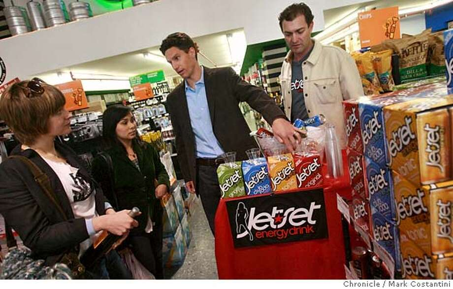 (from left) BevMo customers Shea Greene and Kilani Villiaros listen to Jetset Beverages owners Wyeth Goodenough and Jeff Silver speak about their products at the BevMo on Van Ness Avenue in San Francisco, CA on February 22, 2008. Photo by Mark Costantini / San Francisco Chronicle. MANDATORY CREDIT FOR PHOTOG AND SAN FRANCISCO CHRONICLE/NO SALES-MAGS OUT Photo: Mark Costantini