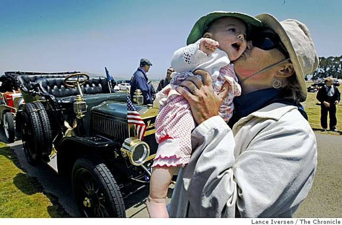 Emily Anderson, is reunited with her five month old daughter Kaisa Andriguez after she drove her fathers 1909 Maxwell Model DA car, into San Francisco's Crissy Field parking lot Thursday July 9, 2009 ending a month long re-creation of the first transcontinental car trip by a woman, made exactly a century ago. In the 1909 trip, Alice Huyler Ramsey, drove across the nation to promote the power of women -- who then didn't even have the right to vote. Today, Anderson wants her ride to celebrate the spirit of trail-blazing women. Plus, it's just a darn fine summer adventure to see if a century-old jalopy can make it all the way across the country.