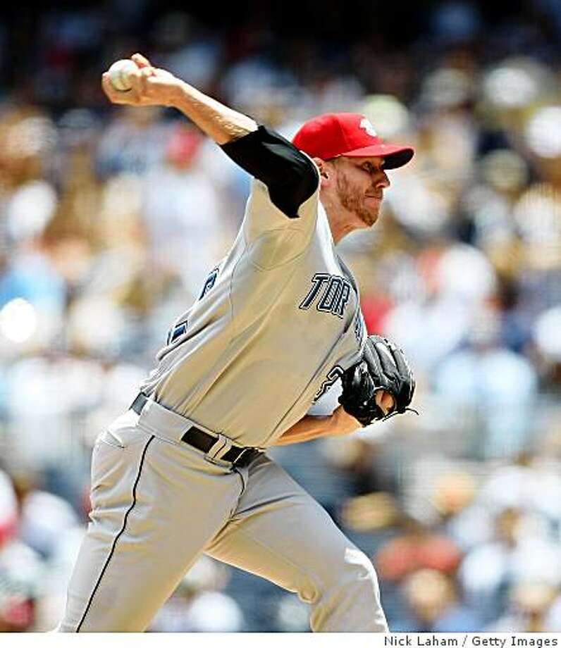 NEW YORK - JULY 04:  Roy Halladay #32 of the Toronto Blue Jays pitches against the New York Yankees on July 4, 2009 at Yankee Stadium in the Bronx borough of New York City.  (Photo by Nick Laham/Getty Images) Photo: Nick Laham, Getty Images