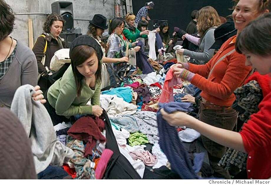 swapsf27_079_mac.jpg Pamela Morrow, left center, of SF, pours over the table of womens shirts. The crazy,frenzy and cloths hungry people that bring in their bags of cloths to trade them for new duds. The Cellspace on Bryant St. became the center of the off-the-wall activity. Michael Macor / The Chronicle Taken on 1/19/08, in San Francisco, CA, USA MANDATORY CREDIT FOR PHOTOG AND SAN FRANCISCO CHRONICLE/NO SALES-MAGS OUT Photo: Michael Macor