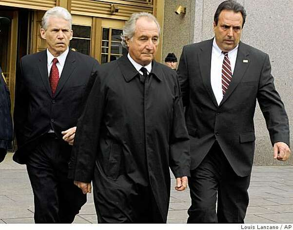 FILE - In this March 10, 2009 file photo, Bernard Madoff exits Manhattan federal court in New York.  Federal regulators on Tuesday, June 16, 2009 reached a settlement with Madoff that prohibits him from working in the securities industry. (AP Photo/ Louis Lanzano, file) Photo: Louis Lanzano, AP