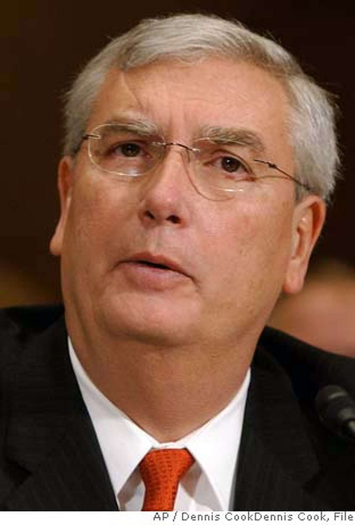 ** FILE ** Some career staffers concerned about the reputation of the Environmental Protection Agency believed that Administrator Stephen Johnson, seen here in a file photo taken Thursday, Jan. 24, 2008, in Washington, would have to consider resigning if he turned down California's request to reduce vehicle greenhouse gas emissions, newly released documents show. (AP Photo/Dennis Cook)