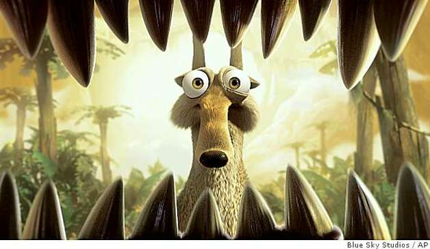 "In this film publicity image released by 20th Century Fox, Scrat once again finds himself in harm's way in a scene from, ""Ice Age: Dawn of the Dinosaurs."" Photo: Blue Sky Studios, AP"