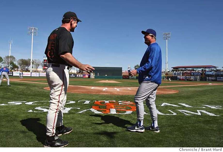 Giants manager Bruce Bochy, left, greeted Cubs manager Lou Pinella before the start of the first contest of the spring. On February 28, 2008 the San Francisco Giants played their first spring training game against the Chicago Cubs at Scottsdale Stadium.  Photo by Brant Ward/San Francisco Chronicle Photo: Brant Ward