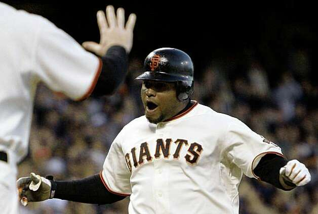 San Francisco Giants' Pablo Sandoval celebrates his grand slam hit off Florida Marlins' Sean West in the fifth inning of a baseball game Monday, July 6, 2009, in San Francisco. (AP Photo/Ben Margot) Photo: Ben Margot, AP