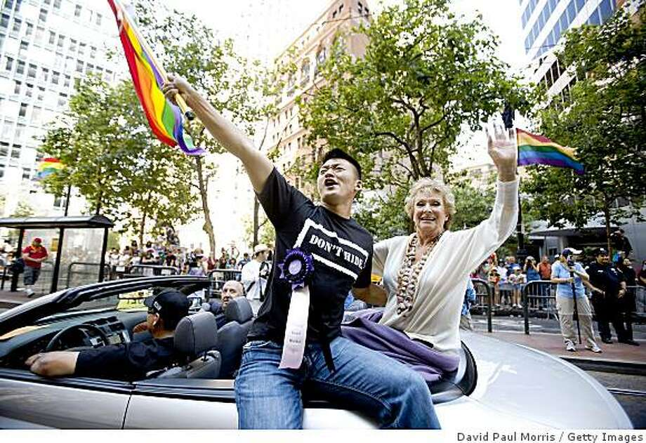 SAN FRANCISCO, CA - JUNE 28:   Celebrity Grand Marshals Lt. Dan Choi, a graduate of West Point and Actress Cloris Leachman takes part in the 39th annual gay pride parade June 28, 2009 in San Francisco, California.  The parade drew hundreds of thousands of people to downtown San Francisco to celebrate gay, lesbian, bisexual and transgender pride. (Photo by David Paul Morris/Getty Images) Photo: David Paul Morris, Getty Images