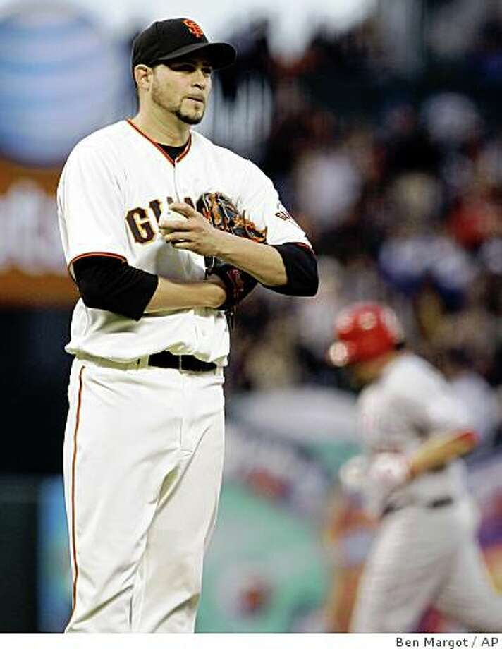 San Francisco Giants pitcher Jonathan Sanchez, left, waits for the bases to clear after giving up a two-run home run to Los Angeles Angels' Maicer Izturis during the fourth inning of a baseball game Tuesday, June 16, 2009, in San Francisco. (AP Photo/Ben Margot) Photo: Ben Margot, AP