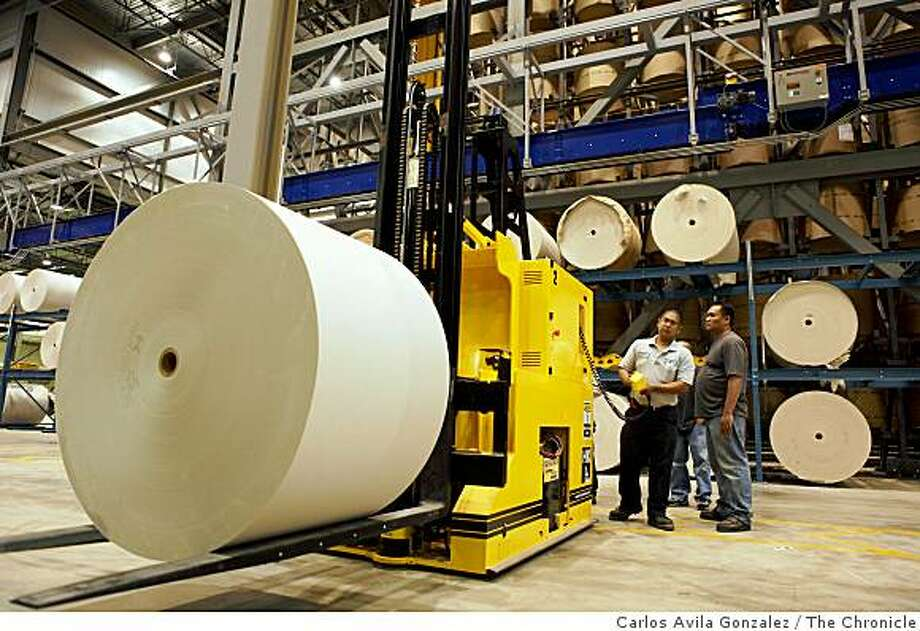Michael Mercado, left, and Richard Borela, guide a forklift with newsprint to feed a printing press at the new Transcontinental printing plant in Fremont, Calif., on Wednesday, June 10, 2009. Photos of the new San Francisco Chronicle printing presses run by Transcontinental in Fremont, Calif., on Thursday, June 18, 2009, during a parallel practice run. Photo: Carlos Avila Gonzalez, The Chronicle