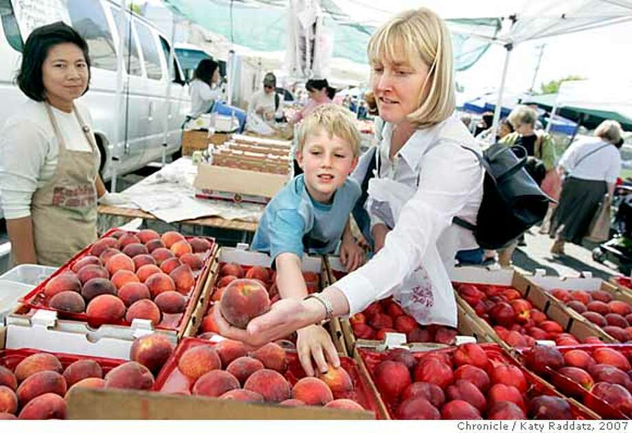 FARMMARKET20_BERKELEY_049_RAD.jpg  SHOWN: Carolyn West and her son Robert West pick out peaches at the Kashiwase Farm stand. The Berkeley Farmers' Market on Derby St. at MLK Dr. These pictures were made on Tuesday, June 5, 2007, in Berkeley, CA. (Katy Raddatz/The Chronicle)  **Carolyn West, Robert West, Kashiwase  Ran on: 02-24-2008  Carolyn West and her son Robert can't help but notice that food prices went up by 6.8 percent in the Bay Area in 2007. Photo: Katy Raddatz