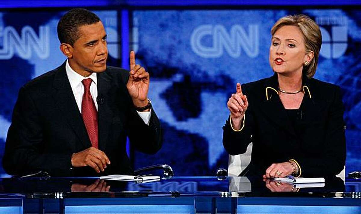 Barack Obama and Hillary Rodham Clinton debate at the Austin Democratic Debate in the Recreational Sports Center on the University of Texas campus in Austin, Texas, Thursday, Feb. 21, 2008. (AP Photo/Deborah Cannon, Pool)