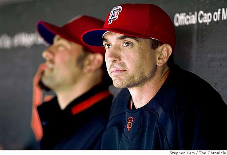 Pitcher Ryan Sadowski (56), right, of the San Francisco Giants, watches the game from the dugout during Giants' 7-1 loss to the visiting Houston Astros at AT&T Park in San Francisco Sunday, July 5, 2009. Photo: Stephen Lam, The Chronicle