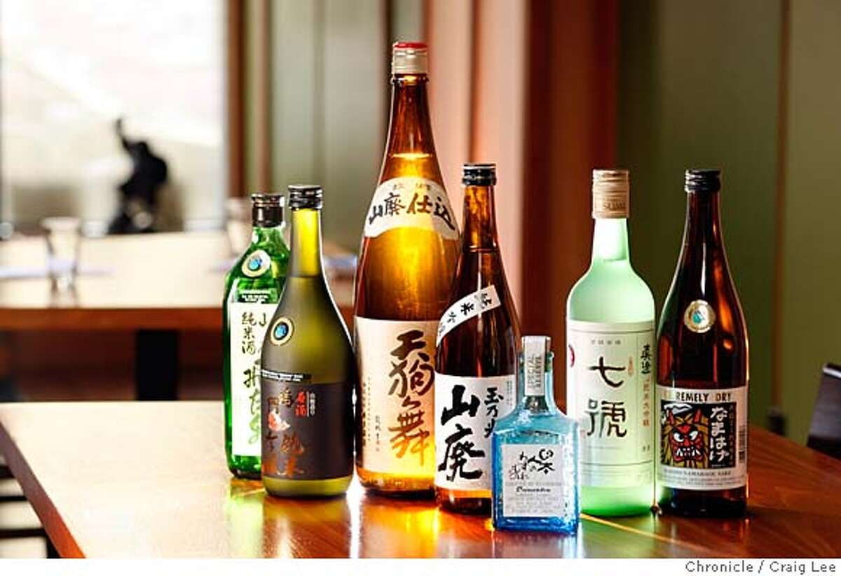 Seven sake bottles photographed on location at Sebo restaurant at 517 Hayes Street. The bottles are, left-right: Hiraizumi Yamahai Tokubetsu Junmai, Narutotai Ginjo