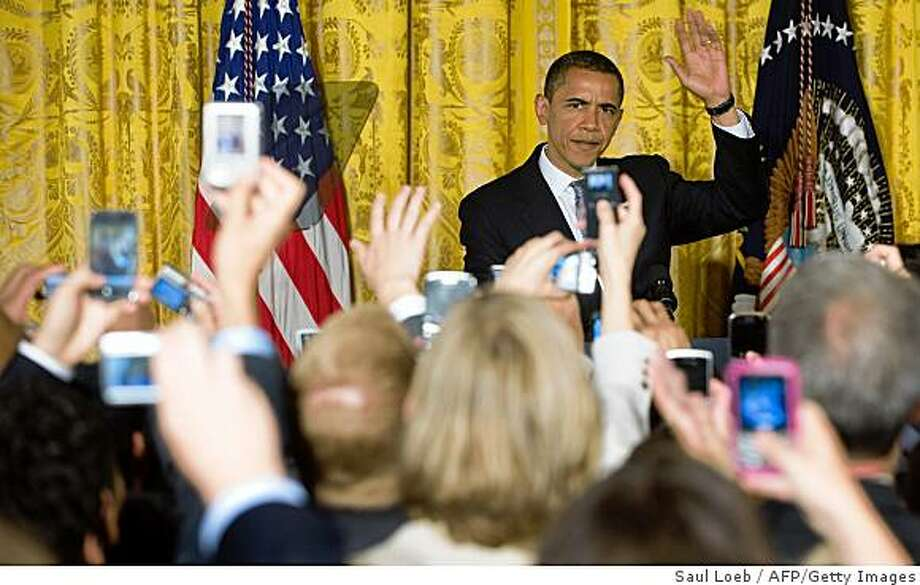 US President Barack Obama waves upon arrival as he hosts an event for LGBT Pride Month in the East Room of the White House in Washington, DC, June 29, 2009. Photo: Saul Loeb, AFP/Getty Images