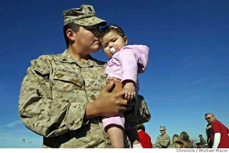 Navy Corpman, Reymundo Parra clutches his 8 month old daughter Abigal, as he prepares to depart to begin his 3rd tour of iraq. Corpman Parra, volunteered to return to be with his Marines out of country. Photo by Michael Macor/ San Francisco Chronicle , on 2/26/08 Photo: Michael Macor