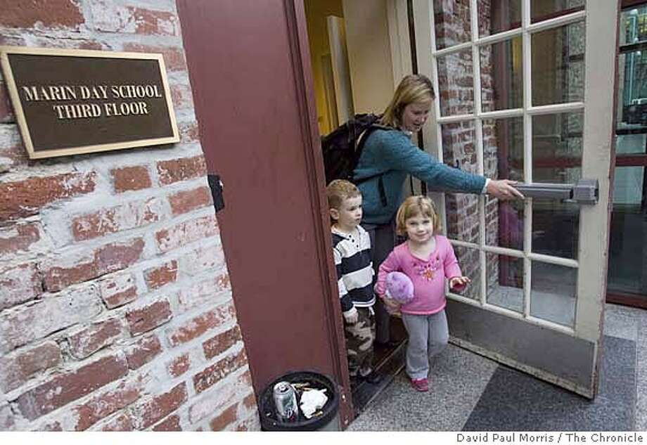 James Freeman, 5, and his sister Sarah Freeman, 3 walk with their mom, Diane Freeman to the Transbay terminal to catch a bus home to Alameda February 25, 2008 in San Francisco, California. Photo by David Paul Morris / San Francisco Chronicle MANDATORY CREDIT FOR PHOTOGRAPHER AND SAN FRANCISCO CHRONICLE/NO SALES-MAGS OUT Photo: David Paul Morris
