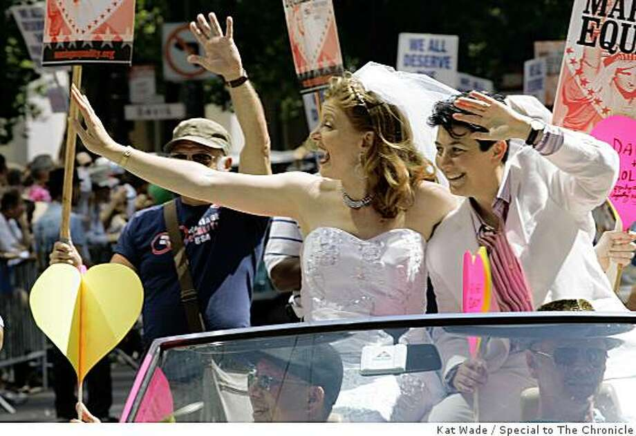 Community grand marshals Molly McKay, left, and Davina Kotulksi ride in the Gay Pride Parade on Market Street in San Francisco on Sunday. Photo: Kat Wade, Special To The Chronicle