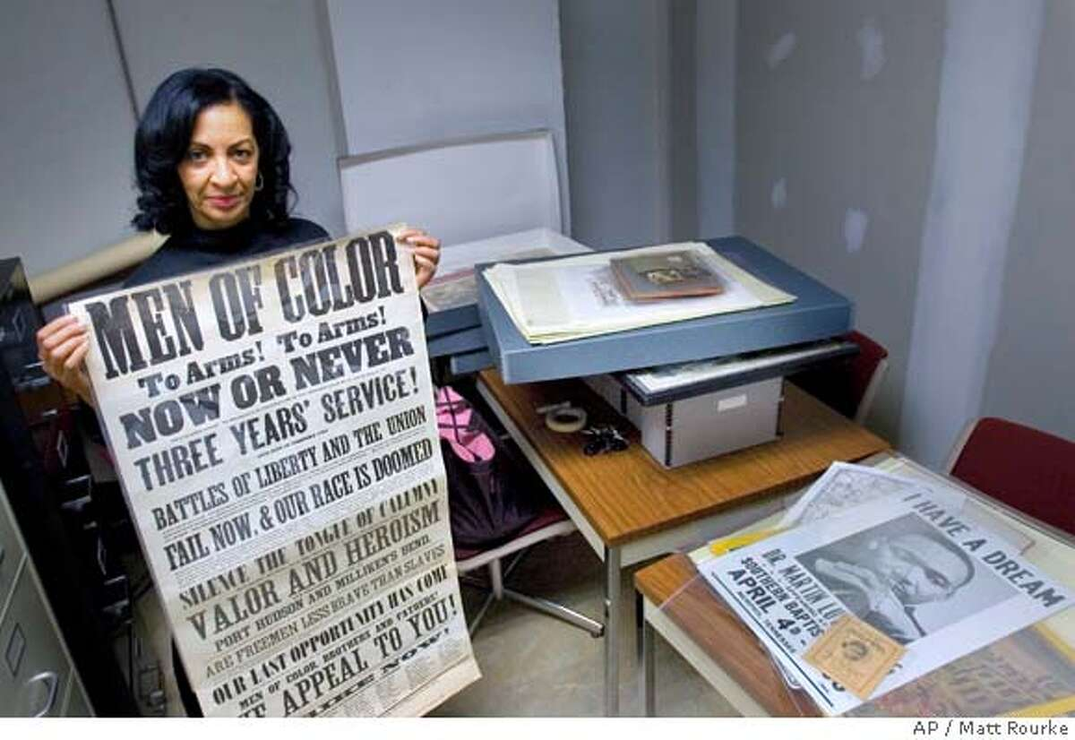 Curator Diane Turner displays an item from the Charles L. Blockson Afro-American Collection at Temple University in Philadelphia, Wednesday, Feb. 13, 2008. The collection contains over 30,000 historical items, some dating to the 16th century. (AP Photo/Matt Rourke)