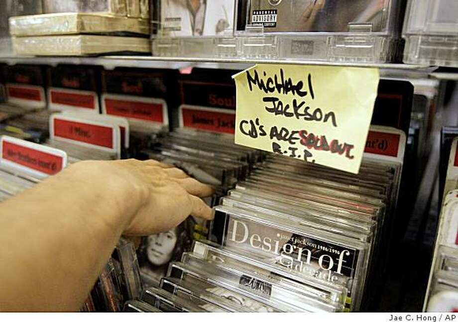 A shopper browses through a shelf to buy a Michael Jackson CD at a music store in Hollywood section of Los Angeles, Thursday, June 25, 2009. Michael Jackson's death has led to skyrocketing sales of his music and videos at record stores and online. (AP Photo/Jae C. Hong) Photo: Jae C. Hong, AP