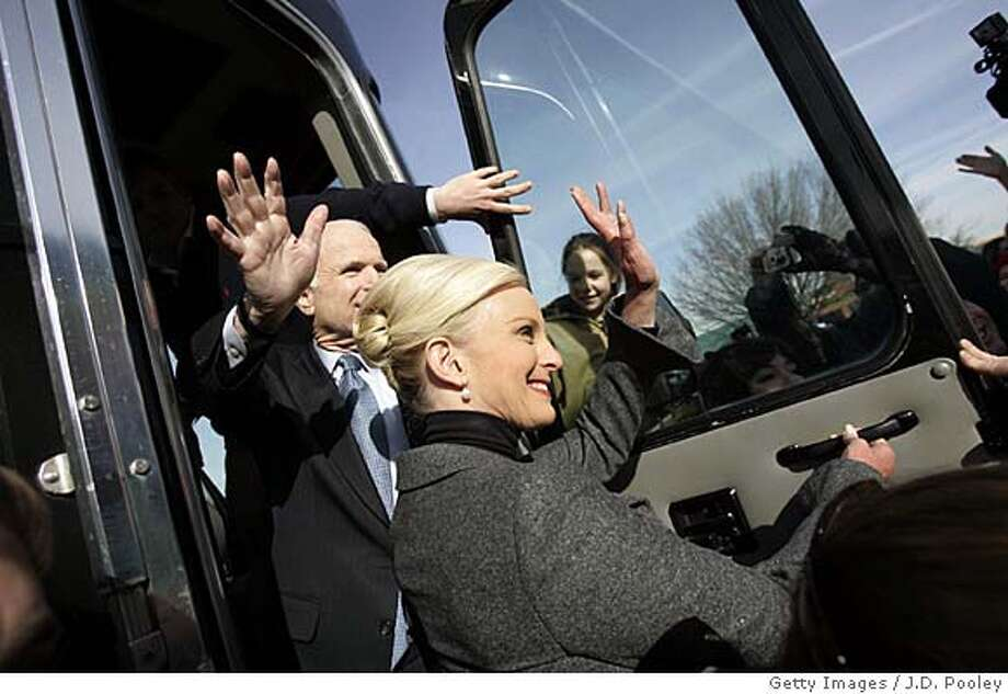 PERRYSBURG, OHIO - FEBRUARY 21: Republican presidential hopeful Sen. John McCain (R-AZ) (L) and his wife Cindy wave to supporters while leaving Charlie's Restaurant February 21, 2008 in Perrysburg, Ohio. McCain is campaigning against former Arkansas Gov. Mike Huckabee ahead of the March 4 primaries in Ohio, Texas, Rhode Island and Vermont. (Photo by J.D. Pooley/Getty Images)  Ran on: 02-24-2008  John McCain and his wife, Cindy, wave to supporters during a campaign stop in Perrysburg, Ohio. Photo: J.D. Pooley
